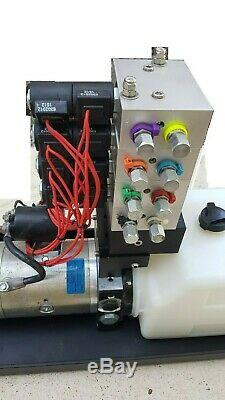 Hydraulic 12 VDC with electr double acting directional control valve, 4 spool